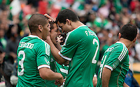 Javier Hernandez (center) celebrates with Francisco Rodriguez (2) and Carlos Salcido (3) after the goal. Mexico defeated Paraguay 3-1 at the Oakland Coliseum in Oakland, California on March 26th, 2011.