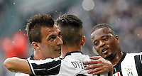 Calcio, Serie A: Juventus vs Sampdoria. Torino, Juventus Stadium, 14 maggio 2016. <br /> Juventus' Paulo Dybala, center, celebrates with teammates Mario Mandzukic, left, and Patrice Evra, after scoring during the Italian Serie A football match between Juventus and Sampdoria at Turin's Juventus Stadium, 14 May 2016.<br /> UPDATE IMAGES PRESS/Isabella Bonotto