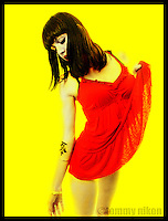 Little red dress on yellow