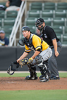 West Virginia Power catcher Taylor Gushue (17) checks the runner at third base after blocking a pitch in the dirt as home plate umpire Ben Sonntag looks n during the game against the Kannapolis Intimidators at Intimidators Stadium on July 2, 2015 in Kannapolis, North Carolina.  The Power defeated the Intimidators 5-1.  (Brian Westerholt/Four Seam Images)
