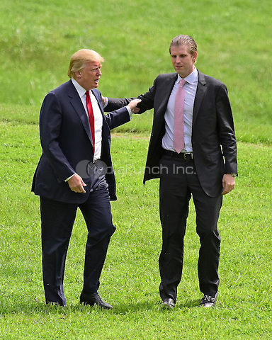 Donald Trump, a candidate for the 2016 Republican nomination for President of the United States, is welcomed by his son, Eric, prior to appearing at the ribbon cutting for the Albemarle Estate at the Trump Winery in Charlottesville, Virginia on Tuesday, July 14, 2015. <br /> Credit: Ron Sachs / CNP/MediaPunch<br /> <br /> (RESTRICTION: NO New York or New Jersey Newspapers or newspapers within a 75 mile radius of New York City)