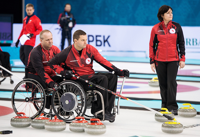 Sochi, RUSSIA - Mar 7 2014 -  Dennis Thiessen, Mark Ideson and Wendy Morgan (team leader) of Canada's Wheelchair Curling Team trains before the Sochi 2014 Paralympic Winter Games in Sochi, Russia.  (Photo: Matthew Murnaghan/Canadian Paralympic Committee)