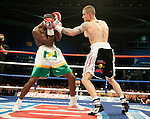 GLASGOW, SCOTLAND - MARCH 10: Ricky Burns of Scotland Paulus Moses of Namibia exchange blows during the WBO world lightweight title fight at the Braehead Arena on March 10, 2012 in Glasgow, Scotland. (Photo by Rob Casey/Getty Images)