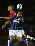 Manchester United's Rio Ferdinand and Inter Milan's Adriano. Pic SPORTIMAGE/Dave Thompson..Pre-Season Friendly..Manchester United v Internazionale..1st August, 2007..--------------------..Sportimage +44 7980659747..admin@sportimage.co.uk..http://www.sportimage.co.uk/