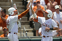 Texas Longhorns designated hitter Madison Carter (35) is greeted by teammate Kacy Clemens (42) during the NCAA Super Regional baseball game against the Houston Cougars on June 7, 2014 at UFCU Disch–Falk Field in Austin, Texas. The Longhorns are headed to the College World Series after they defeated the Cougars 4-0 in Game 2 of the NCAA Super Regional. (Andrew Woolley/Four Seam Images)
