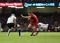 Pictured: Rhys Priestland of Wales (C) against Dominiko Waqaniburotu of Fiji (L). Saturday 15 November 2014<br />