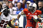 SIOUX FALLS, SD - JUNE 16:  Carl Sims #4 from the Sioux Falls Storm turns to look at Kwaheem Smith #22 from the Omaha Beef on the opening play for the Storm results in a 40 yard catch in the first quarter Saturday night at the Sioux Falls Arena. (Photo by Dave Eggen/Inertia)