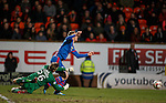 Dundee Utd keeper Michal Szromnik fouls Marley Watkins for a penalty and a straight red card