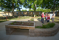 NWA Democrat-Gazette/BEN GOFF @NWABENGOFF<br /> A concrete and brick patio with retaining walls, raised planting beds and frames to hold white boards comprise the outdoor classroom Monday, May 15, 2017 during a ribbon-cutting for the new outdoor classroom at Northside Elementary School in Rogers. The school took the oportunity to thank the Rogers Public Education Foundation and local businesses including Lowe's Home Improvement, Milestone Construction Company and Gall Excavation Inc. which made the project possible. The outdoor classroom was complemented by raised planting beds and benches made by local Eagle Scouts, and a butterfly garden built by teachers.