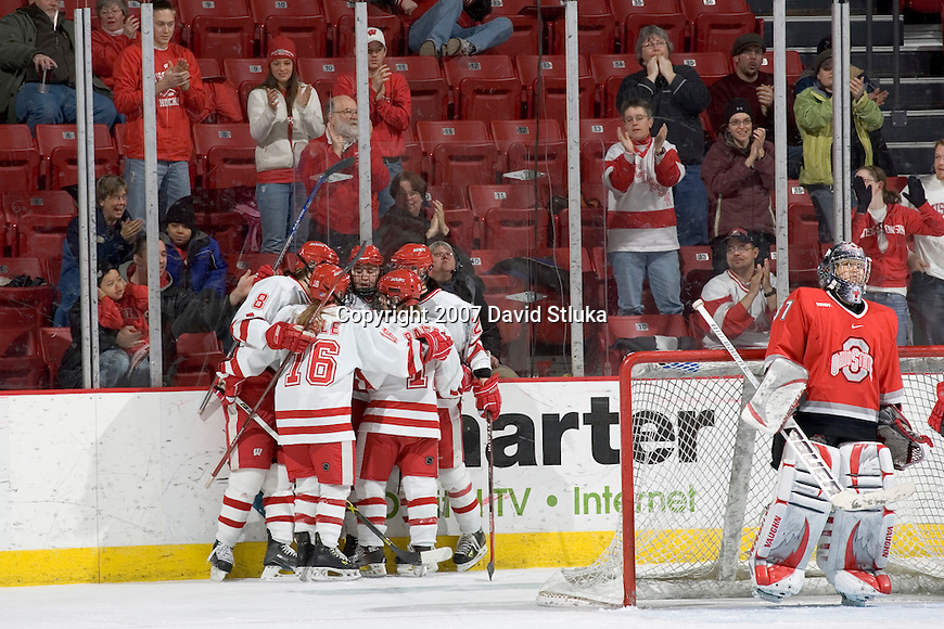 MADISON, WI - FEBRUARY 11: The Wisconsin Badgers women's hockey celebrates a goal in the 1st period against the Ohio State Buckeyes at the Kohl Center on February 11, 2007 in Madison, Wisconsin. The Badgers beat the Buckeyes 3-2. (Photo by David Stluka)