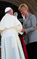 Papa Francesco saluta il Ministro della Difesa Roberta Pinotti durante un'udienza ai componenti dell'Arma dei Carabinieri in occasione del bicentenario della fondazione, in Piazza San Pietro, Citta' del Vaticano, 6 giugno 2014.<br /> Pope Francis greets Italian Defense Minister Roberta Pinotti during an audience with Carabinieri paramilitary police corps' members on the occasion of the 200th anniversary foundation, in St. Peter's Square, Vatican City, 6 June 2014.<br /> UPDATE IMAGES PRESS/Isabella Bonotto<br /> <br /> STRICTLY ONLY FOR EDITORIAL USE