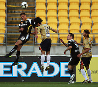 Ben Sigmund beats Jin-Hyung Song to a header as Shane Smeltz and Adam Griffiths look on during the A-League match between Wellington Phoenix and Newcastle Jets at Westpac Stadium, Wellington, New Zealand on Sunday, 4 January 2009. Photo: Dave Lintott / lintottphoto.co.nz