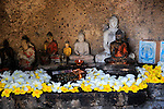 Rankot Vihara stupa UNESCO World Heritage Site, the ancient city of Polonnaruwa, Sri Lanka, Asia offerings to small Buddha figures
