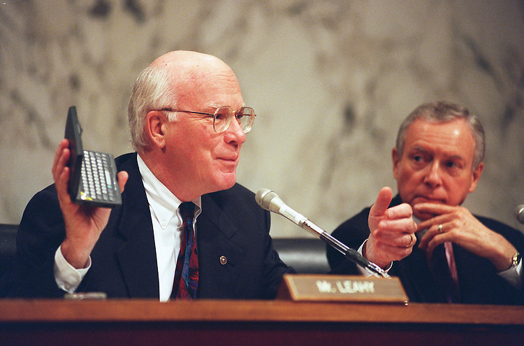 11/4/97.COMPETITION IN THE DIGTAL AGE:Patrick J. Leahy,D-Vt., talks about how he accesses the internet by using his pocket computer. Chairman Orrin G. Hatch,R-Utah, looks on during the Senate Judiciary Committee hearing on competition,innovation and public policy in the digital age..CONGRESSIONAL QUARTERLY PHOTO BY DOUGLAS GRAHAM