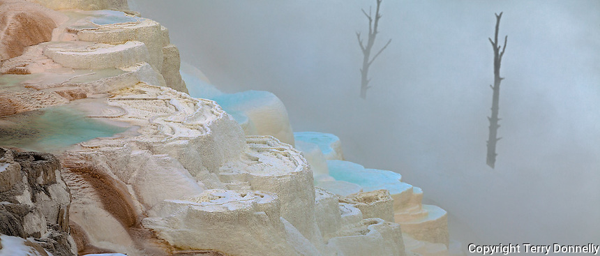 Yellowstone National Park, Wyoming: <br /> Pools on Canary Spring travertine terraces, an active thermal feature at Mammoth Hot Springs, in winter