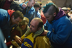 Stewards comfort Raul Beites after he finished his walk representing Jarramplas and beating his drum during the Jarramplas Festival on January 20, 2015 in Piornal, Spain. The centuries old Jarramplas festival takes place annually every January 19-20 on Saint Sebastian Day. Even though the exact origins of the festival are not known, various theories exist including the mythological punishment of Caco by Hercules, a relation to ceremonies celebrated by the American Indians that were seen by the first conquerors, to a cattle thief ridiculed and expelled by his village neighbours. It is generally believed to symbolize the expulsion of everything bad. This year the people who represented Jarramplas were Angel Cerro Fernandez on 19 January and Carlos Calle Rodríguez 47 and Raúl Beites Sánchez 34 on 20 January. (c) Pedro ARMESTRE