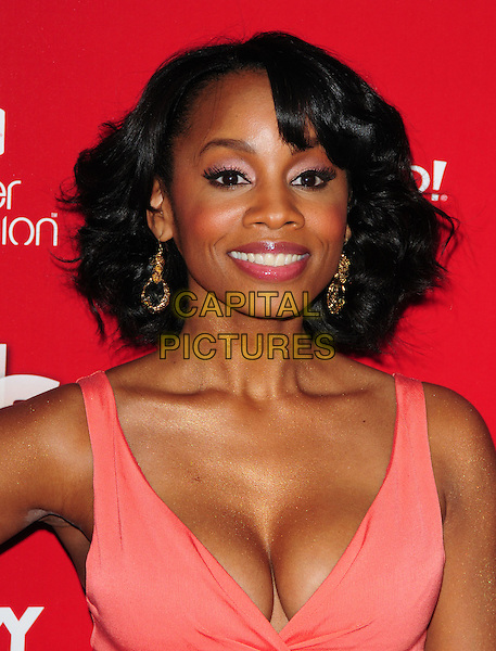 ANIKA NONI ROSE                            .US Weekly's Hot Hollywood Party 2009 held at Voyeur, West Hollywood, California, USA. .November 18th, 2009.headshot portrait cleavage dangling gold earrings pink coral.CAP/RKE/DVS.©DVS/RockinExposures/Capital Pictures.