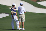 Rory McIlroy and his caddy wait fr the green to clear on the 7th hole during  Day 3 at the Dubai World Championship Golf in Jumeirah, Earth Course, Golf Estates, Dubai  UAE, 21st November 2009 (Photo by Eoin Clarke/GOLFFILE)