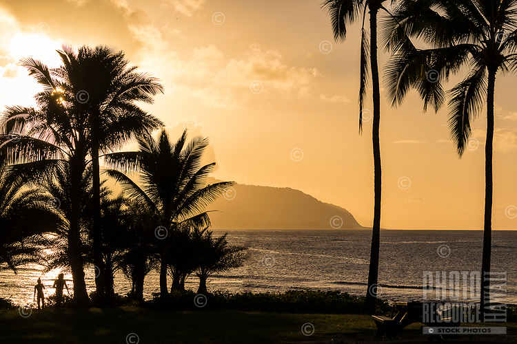 People watch the sun setting at Hale'iwa Ali'i Beach Park, North Shore, O'ahu.