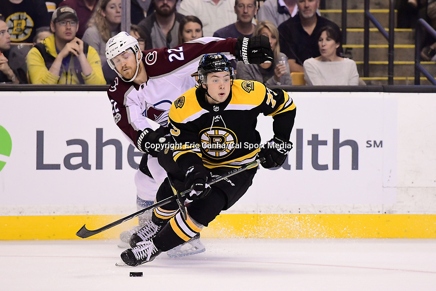 October 9, 2017: Colorado Avalanche center Colin Wilson (22) lifts the stick of Boston Bruins defenseman Charlie McAvoy (73) during the NHL game between the Colorado Avalanche and the Boston Bruins held at TD Garden, in Boston, Mass. Colorado defeats Boston 4-0. Eric Canha/CSM