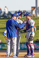 South Bend Cubs pitching coach David Rosario talks with pitcher Justin Steele (21) and catcher Tyler Alamo (22) on the mound against the Great Lakes Loons on May 18, 2016 at Dow Diamond in Midland, Michigan. Great Lakes defeated South Bend 5-4. (Andrew Woolley/Four Seam Images)