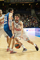 Real Madrid´s Sergio Llull and Anadolu Efes´s Milko Bjelica during 2014-15 Euroleague Basketball match between Real Madrid and Anadolu Efes at Palacio de los Deportes stadium in Madrid, Spain. December 18, 2014. (ALTERPHOTOS/Luis Fernandez) /NortePhoto /NortePhoto.com