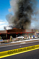 AJ ALEXANDER/AAP- 071708 - Richardson's Restaurant is a well know Valley restaurant in central Phoenix, goes up in flames and smoke that started some time after 2 p.m.  on this 113 degree day. The stip mall is located on Bethany Home Rd. & 16th St. Friday July 17, 2009.  Photo by AJ Alexander