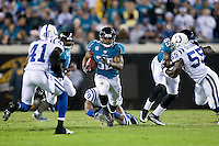 December 17, 2009:    Jacksonville Jaguars running back Maurice Jones-Drew (32) runs for yardage during AFC South Conference action between the Indianapolis Colts and Jacksonville Jaguars at Jacksonville Municipal Stadium in Jacksonville, Florida.  Indianapolis defeated Jacksonville 35-31............