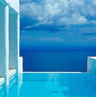 An idyllic view over the sea from the end of an infinity pool
