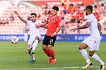 Jamal Rashed Abdulrahman of Bahrain (L) fights for the ball with Hwang Heechan of South Korea (C) during the AFC Asian Cup UAE 2019 Round of 16 match between South Korea (KOR) and Bahrain (BHR) at Rashid Stadium on 22 January 2019 in Dubai, United Arab Emirates. Photo by Marcio Rodrigo Machado / Power Sport Images