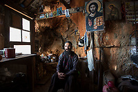 Mount Athos - The Holy Mountain.<br /> Father David in his kitchen. Half of the cells wall is the actual cliff edge which runs down to the water hundreds of feet below. <br /> <br /> Photographer: Rick Findler