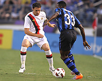 Nsofor Victor Obinna #33 of Inter Milan tries to get past Wayne Bridge #3 of Manchester City during an international friendly match on July 31 2010 at M&T Bank Stadium in Baltimore, Maryland. Milan won 3-0.