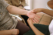 A carer has a hand massage during a Carers Day organised by Haringey Council in north London.