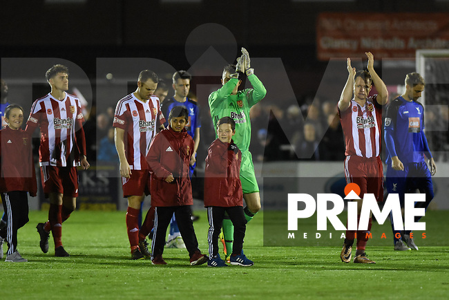 Stourbridge captain Tom Tonks leads out his team prior to the FA Cup 1st round replay match between Stourbridge and Whitehawk  at the War Memorial Athletic Ground, Stourbridge, England on 14 November 2016. Photo by Garry Griffiths.