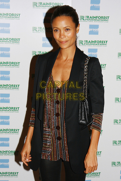 THANDIE NEWTON .Attends the photography exhibition 'The People of the Forest' - 20 years of images from the Rainforest Foundation, Proud Gallery, Camden, London, England,  October 6th 2009..half length black jacket brown top buttons cardigan striped bag chain strap shoulder straps .CAP/MAR.© Martin Harris/Capital Pictures.