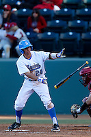 Brian Carroll #24 of the UCLA Bruins bats against the Oklahoma Sooners at Jackie Robinson Stadium on March 9, 2013 in Los Angeles, California. (Larry Goren/Four Seam Images)