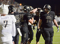 NWA Democrat-Gazette/CHARLIE KAIJO Bentonville High School players react after a score during a football game, Friday, November 2, 2018 at Bentonville High School in Bentonville.