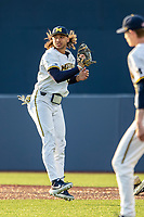 Michigan Wolverines first baseman Jordan Brewer (22) in action against the Western Michigan Broncos on March 18, 2019 in the NCAA baseball game at Ray Fisher Stadium in Ann Arbor, Michigan. Michigan defeated Western Michigan 12-5. (Andrew Woolley/Four Seam Images)