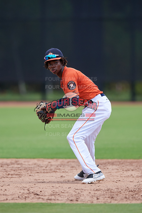 GCL Astros shortstop Freudis Nova (16) throws to first base during a game against the GCL Marlins on August 5, 2018 at FITTEAM Ballpark of the Palm Beaches in West Palm Beach, Florida.  GCL Astros defeated GCL Marlins 2-1.  (Mike Janes/Four Seam Images)