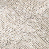 Nami, a hand-cut stone mosaic, shown in polished Botticino and polished Jura Grey.