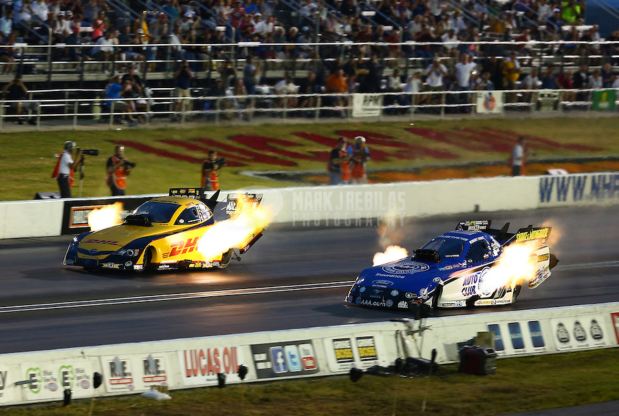 Aug. 31, 2013; Clermont, IN, USA: NHRA funny car driver Robert Hight (right) races alongside Del Worsham during qualifying for the US Nationals at Lucas Oil Raceway. Mandatory Credit: Mark J. Rebilas-