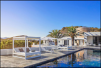BNPS.co.uk (01202 558833)<br /> Pic: Kuhn&amp;Partner/BNPS<br /> <br /> Go on, push the boat out...<br /> <br /> Wealthy revellers wanting to spend their Ibiza holiday in the lap of luxury can now rent this entire island half a mile off the coast - but they will have to fork out a staggering &pound;12,000 a night for the privilege.<br /> <br /> Deep-pocketed holidaymakers can get a taste of life as a celebrity on 98-acre Tagomago Island, which features its own plush villa for 10 people, a fully-stocked bar and nine staff to wait on them hand and foot.<br /> <br /> Nestled in the crystal-clear turquoise waters of the Mediterranean, the tiny private island has recently played host to footballing star Cristiano Ronaldo and Rolling Stones guitarist Ronnie Wood.<br /> <br /> Tagomago can be hired for a whopping &pound;85,000 a week at the height of summer - the equivalent to &pound;500 an hour - but prices drop to an only slightly more affordable &pound;70,000 for the rest of the year.