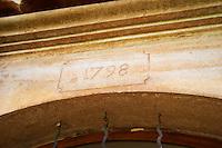 1798. Chateau de Lascaux, Vacquieres village. Pic St Loup. Languedoc. A door. France. Europe.