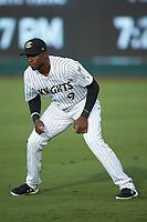 Luis Robert (9) of the Charlotte Knights warms up in the outfield prior to the game against the Gwinnett Braves at BB&T BallPark on July 12, 2019 in Charlotte, North Carolina. The Stripers defeated the Knights 9-3. (Brian Westerholt/Four Seam Images)