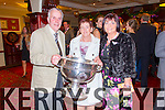 Pictured with the Sam Maguire at the Brosna GAA Victory Social in the Devon Inn Hotel, Templeglantine on Monday night were L-R: John and Gabrielle O'Sullivan and Mary Finnegan, Brosna.