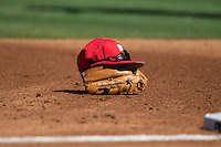The cap of Houston Cougars third baseman Justin Montemayor (not pictured) sits on top of his glove during the game against the Texas Tech Red Raiders in game one of the 2016 Shriners Hospitals for Children College Classic at Minute Maid Park on February 26, 2016 in Houston, Texas.  The Red Raiders defeated the Cougars 3-2.  (Brian Westerholt/Four Seam Images)