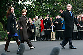 United States President George W. Bush (R) walks with his wife First Lady Laura Bush and daughter Barbara Bush as they prepare to depart the White House on Marine One November 26, 2008 in Washington, DC. President Bush and his family are headed to Camp David for the Thanksgiving holiday. <br /> Credit: Mark Wilson / Pool via CNP
