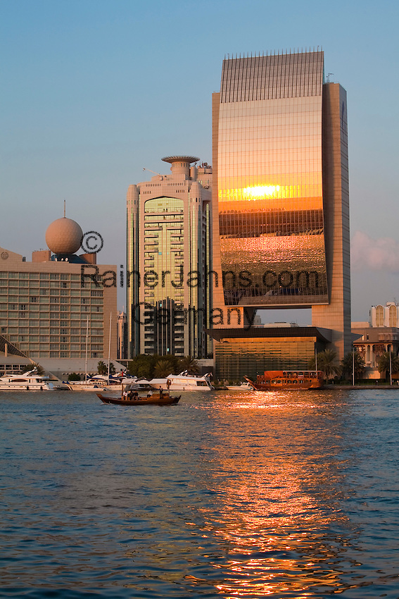 United Arab Emirates, Dubai: View over the Dubai Creek. Sunset reflected in the National Bank of Dubai building