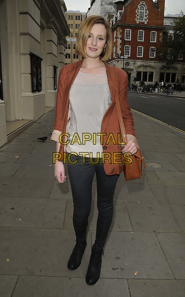 LAURA CARMICHAEL .The Royal Opera House Cinema Season launch party, Royal Opera House, Bow St., London, Thu/22nd/Sept/2011..September 22nd, 2011.full length brown jacket blazer bag purse jeans denim white top.CAP/CAN.©Can Nguyen/Capital Pictures.