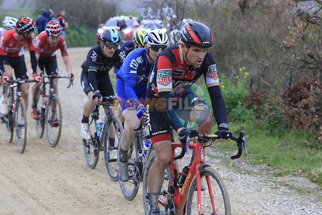 Riders led by Greg Van Avermaet (BEL) BMC Racing Team on gravel sector 8 Monte Santa Maria during the 2017 Strade Bianche running 175km from Siena to Siena, Tuscany, Italy 4th March 2017.<br /> Picture: Eoin Clarke | Newsfile<br /> <br /> <br /> All photos usage must carry mandatory copyright credit (&copy; Newsfile | Eoin Clarke)